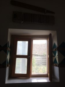 Century old renovated window.  Above are old washing instruments