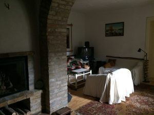 Common room with fire place and baking oven